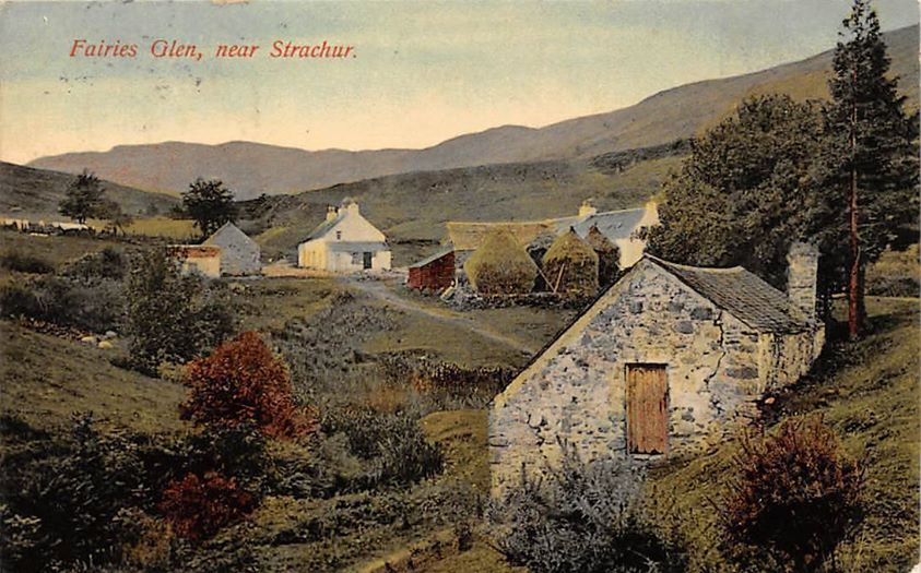 Colour postcard of Glensluain, showing the houses haystacks and mill. Titled Fairies Glen, near Strachur because it is near to The Fairy Knowe (extinct vulcano)