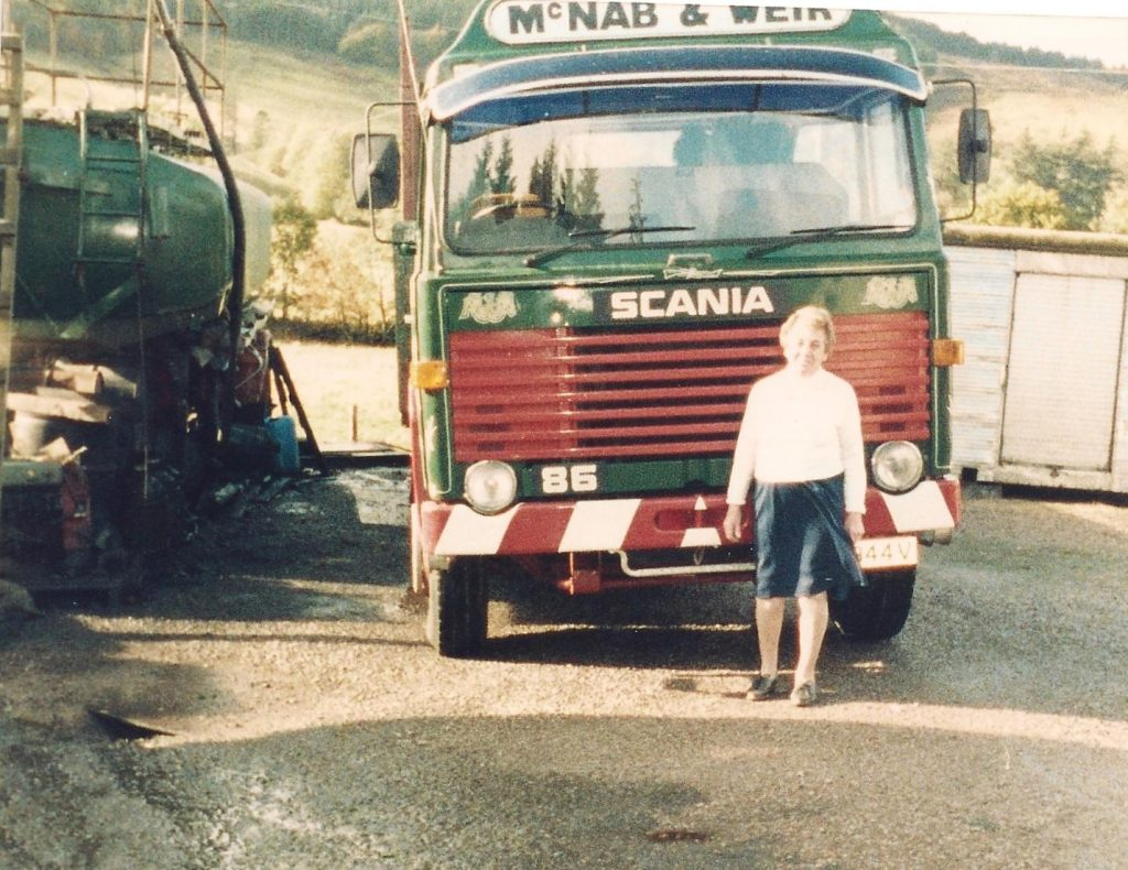 Mrs. McNab standing in front of McNab & Weir Lorry